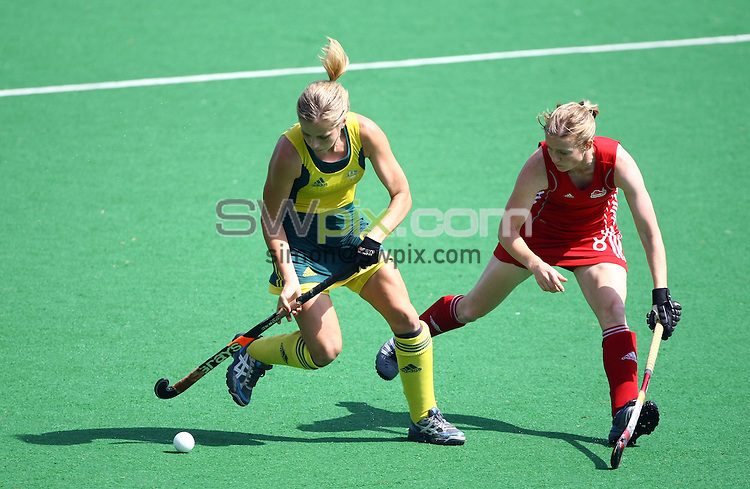 PICTURE BY VAUGHN RIDLEY/SWPIX.COM - Hockey - XIX Commonwealth Games - Women's Semi-Finals, England v Australia, Major Dhyan Chand National Stadium, New Dehli, India - 11/10/10...Copyright - Simon Wilkinson - 07811267706...Australia's Ashleigh Nelson and England's Helen Richardson.