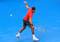 Juan Martin del Potro of Argentina hits a backhand to Nicolas Mahut of France during their men's singles match at the Sydney International tennis tournament in Sydney, Australia, Wednesday, Jan. 8, 2014.  IMAGE RESTRICTED TO EDITORIAL USE ONLY. Photo by Daniel Munoz/VIEWpress