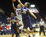 "Ole Miss's Bianca Thomas (45) shoots as LSU's Latear Eason (3) and Taylor Turnbow (35) defend  on Sunday, January 17, 2010 at the C.M. ""Tad"" Smith Coliseum in Oxford, Miss. Bianca Thomas scored 42 points, a C.M. ""Tad"" Smith record for a woman's game, in the Lady Rebels 80-71 win."