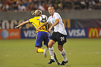 Aby Wambach turns Sara Larsson...USWNT tied Sweden 1-1 at Morison Stadium, Nebraska.