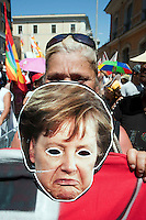 Roma 22 Giugno 2012.Manifestazione  dei sindacati di base contro le politiche economiche e sociali del Governo Monti..Manifestante con la maschera di Angela Merkel