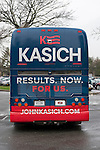"Hempstead, New York, USA. April 4, 2016. The John Kasich Campaign Bus, with slogan ""RESULTS. NOW. FOR US.' on rear, is leaving rainy campus, after the Republican presidential candidate and governor of Ohio, hosted a Town Hall at Hofstra University David Mack Student Center in Long Island. The New York primary is April 19, and Kasich is the first of the three GOP presidential candidates to campaign in Nassau and Suffolk Counties, and is in third place in number of delegates won."
