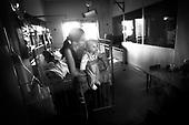 Wroclaw 02.02.2007 Poland.<br /> Klaudia Haszkiewicz, 7 month with mom. Klaudia is actual after tumor performed operation.<br /> Clinical Hospital, oncology and haematology departmend. This is one of the important Haematologic Hospital in all over Poland, however hospital board stopped to discharge a rising debt. In this connection authorities must close hospital, but goverment had no idea what should do with terminaly ill children.<br /> (Photo: Adam Lach / Napo Images)<br /> <br /> Akedemicki Szpital Kliniczny, oddzial onkologii i hematologii. Temu jednemu z najwazniejszych w Polsce osrodkowi szpitalnemu grozi zamkniecie w powodu dlugow, ktore niezaleznie od wplat NFZ-tu regularnie sciaga komornik. Z calej Polski ludzie charytatywnie wplacaja pieniadze by uratowac szpital i los dzieci dla ktorych to miejsce jest jedynym ratunkiem.
