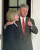 United States President Bill Clinton gives a &quot;thumbs-up&quot; when asked about his meeting at the White House in Washington, D.C. with King Hussein of Jordan on March 19, 1998.  First lady Hillary Rodham Clinton looks on.<br /> Credit: Ron Sachs / CNP
