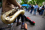 "The extremely popular Saturday Portland Farmers' Market, located in the South Park Blocks near the Portland State University Campus, offers a large selection of locally grown organic produce, fish, meat and foodstuffs.  Pictured here is the band,"" The Cardboard Songsters,"" Felix Manx and Nate Lumbard who perform at the market."