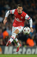 LONDON, ENGLAND - Nov 26: Arsenal's Mesut Ozil during the UEFA Champions League match between Arsenal from England and Olympique de Marseille from France played at The Emirates Stadium, on Novemer 26, 2013 in London, England. (Photo by Mitchell Gunn/ESPA)