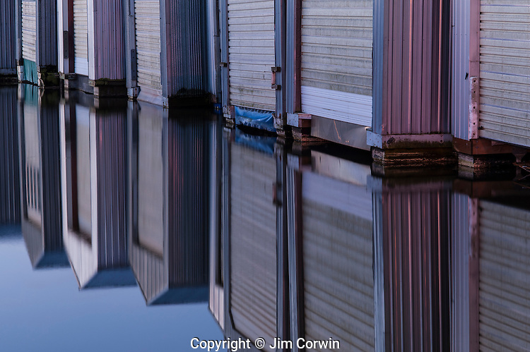 Sunrise boat houses in rows along the waterfront on Puget Sound