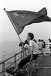 The Peoples Republic of China. Shanghai.  A young girl travels back to her studies in Shanghai from her parents home on Chongming Island The silt created island at the mouth of the Yangzi is famous for its small and very tasty crabs available in the local restaurants They breed out at sea but live in the fresh water of the many rivers and inlets on the island. FROM THE BOOK SHANGHAI ODYSSEY BY HOMER SYKES WITH THE SUPPORT OF THE GRIMSTONE FOUNDATION. PUBLISHED BY DEWI LEWIS PUBLISHING ISBN 1-89923514-0