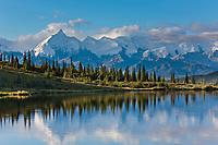 Alaska range mountains, including Mt Brooks, reflect in the still morning water of Wonder Lake, Denali National Park, interior, Alaska.