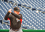 14 May 2016: Miami Marlins first base coach Perry Hill taps out grounders prior to the first game of a double-header against the Washington Nationals at Nationals Park in Washington, DC. The Nationals defeated the Marlins 6-4 in the afternoon matchup.  Mandatory Credit: Ed Wolfstein Photo *** RAW (NEF) Image File Available ***