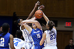 25 November 2014: Buffalo's Kristen Sharkey (25) is stripped of the ball by Duke's Rebecca Greenwell (23) and Amber Henson (behind). The Duke University Blue Devils hosted the State University of New York Buffalo Bulls at Cameron Indoor Stadium in Durham, North Carolina in a 2014-15 NCAA Division I Women's Basketball game. Duke won the game 88-54.