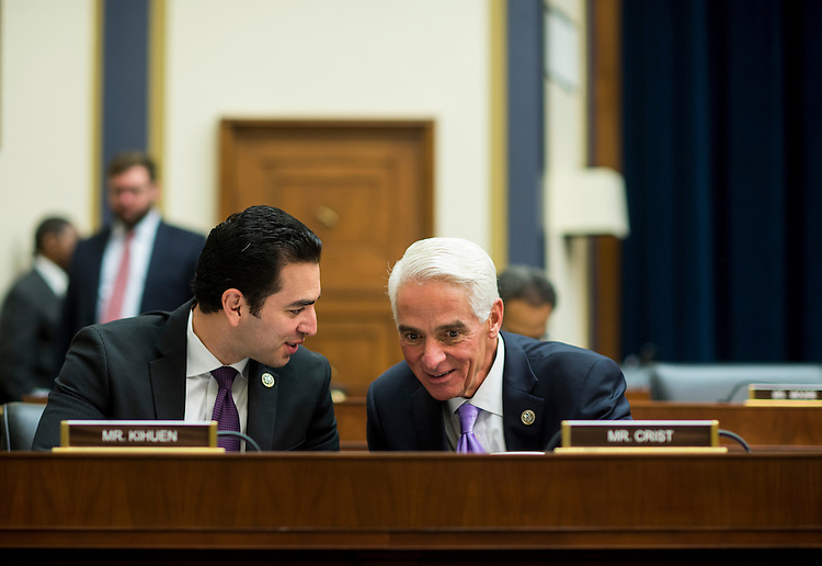 UNITED STATES - FEBRUARY 2: Rep. Ruben Kihuen, D-Nev., left, speaks with Rep. Charlie Crist, D-Fla., during the House Financial Services Committee meeting to organize for the 115th Congress on Thursday, Feb. 2, 2017. (Photo By Bill Clark/CQ Roll Call)