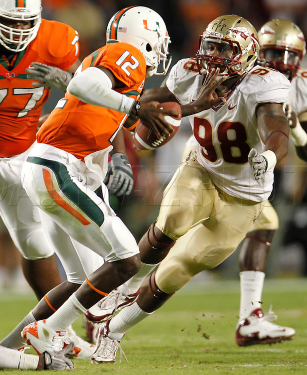 Miami's quarterback Jacory Harris is sacked by Markus White in the first half during the University of Miami vs Florida State University on Saturday October 9, 2010.