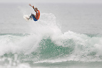 American Kelly Slater lifts off and pulls an air during round of 48 at the 2010 US Open of Surfing in Huntington Beach, California on August 5, 2010.