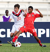 Michael Petrasso (20) of Canada fights for the ball with Romario Piggott (15) of Panama during the semifinals of the CONCACAF Men's Under 17 Championship at Catherine Hall Stadium in Montego Bay, Jamaica. Canada defeated Panama, 1-0.