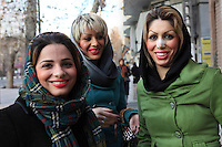 Three young women wearing Western-style clothing, one of whom has recently undergone a plastic surgery procedure on her nose.