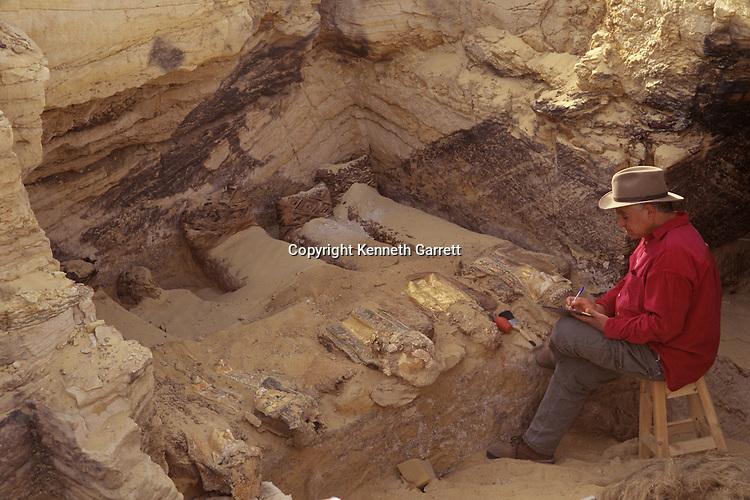 Dr. Zahi Hawass in tomb 54 examining mummiesEgypt; Archaeology; Bahariya Oasis; Greco-Roman;Golden Mummies; Valley of the Golden Mummies; mummies