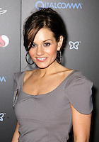 KARA DIOGUARDI.At SWAGG VIP Kid Rock Concert at the Joint inside the Hard Rock Hotel and Casino, Las Vegas, Nevada, USA,.7th January 2010..portrait headshot hoop earrings hair up grey gray black shoulder pads eye contact .CAP/ADM/MJT.© MJT/AdMedia/Capital Pictures.