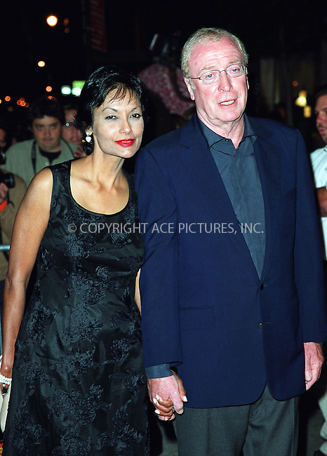 "Michael Caine and his wife attending the New York Premiere of ""Austin Powers in Goldmember"" at Barney's New York on Madison Avenue in New York. July 24, 2002. Please byline: Alecsey Boldeskul/NY Photo Press.   ..*PAY-PER-USE*      ....NY Photo Press:  ..phone (646) 267-6913;   ..e-mail: info@nyphotopress.com"