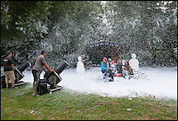 BNPS.co.uk (01202 558833)<br /> Pic: PhilYeomans/BNPS<br /> <br /> Sunny days for snow business...<br /> <br /> Staff are celebrating their success in the way only they can...by turning a warm september day into a Xmas snow scene in seconds.<br /> <br /> The worlds biggest producer of snow is celebrating after another bumper year in which they have supplied the film and television industry with the white stuff from the unlikely headquarters near Stroud in Gloucestershire.<br /> <br /> The tiny British company are the first port of call for Hollywood producers when the on screen temperature drops and they can't wait on the weather - Recent credits include Maleficent, Snow White and the Huntsman and Philomena.<br /> <br /> Homegrown favourites like Dr Who and Downton are also customers, owner Darcy Crownshaw claims 'Everywhere you go the snow you see will probably be ours, from Harrods and Selfridges shop windows to the adverts and programmes on your television and films at the cinema.'