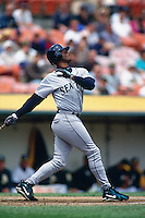 OAKLAND, CA -  Seattle Mariners batter Ken Griffey Jr. in action against the Oakland Athletics in Oakland, CA during the 1997 season. Photo by Brad Mangin.