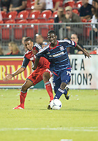 12 September 2012: Chicago Fire forward Patrick Nyarko #14 and Toronto FC midfielder Reggie Lambe #19 in action during an MLS game between the Chicago Fire and Toronto FC at BMO Field in Toronto, Ontario Canada. .The Chicago Fire won 2-1.