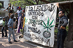 """Youths hold a banner that reads: """"For legalization, a world with marijuana is possible"""", as they attend a rally demanding decriminalization of drug posession after Mexican Congress approved a drug law on April 29 to legalize the possession of small quantities of drugs and mandate treatment for addicts, May 6, 2006 Mexican President Vicente Fox refused to sign a drug decriminalization bill on Wednesday. Photo by Javier Rodriguez"""