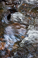 The perpetual motion of a spring creek at the Great Smoky Mountains National Park in North Carolina. Rocks and boulders, shimmering and glistening in the afternoon sunlight.