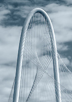 Top of the arch of the Margaret Hill Hunt Bridge in downtown Dallas with nice clouds hoovering above the top of this 400 foot bridge in the city.