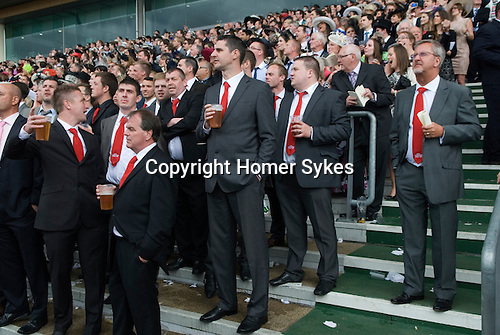 """Royal Ascot horse racing Berkshire. 2012 Group of men wearing red ties that say """" Horners Stag Do 2012"""""""