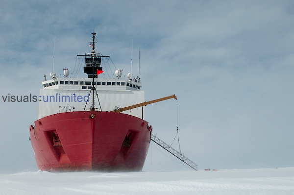 Research ship Healy parks so scientists can get off and collect data on the sea ice, Antarctica.