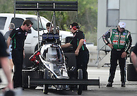 Jan. 16, 2013; Jupiter, FL, USA: NHRA top fuel dragster driver Brittany Force sits in her car as father John Force (right) looks on during testing at the PRO Winter Warmup at Palm Beach International Raceway.  Mandatory Credit: Mark J. Rebilas-