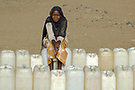 An African woman waits for water in a camp for displaced persons in the Darfur region of Sudan.