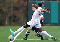 HYATTSVILLE, MD - OCTOBER 26, 2012:  Sean Cowdrey (10) of DeMatha Catholic High Schoo stretches for the ball against Sam Danello (13)l of St. Albans during a match at Heurich Field in Hyattsville, MD. on October 26. DeMatha won 2-0.