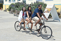 A threesome rolls north along Ocean Front Walk in Santa Monica on Wednesday, May 9, 2012.