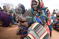 Kenya - Dadaab. A mother qeueing for registration with her son.
