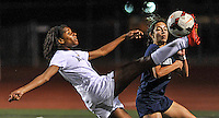 Aliso Niguel's Mia Darden, left, goes up high to kick the ball away from her opponent during the championship game against Chino Hills. Aliso Niguel won 1-0.