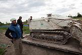 "Donji Rahić. Deminers prepare the remote controlled MV-4 mine-clearance vehicle called ""El Mino""."