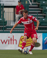 Chicago Fire midfielder Corben Bone (19) passes the ball. In a Third Round U.S. Open Cup match, the Chicago Fire defeated the Rochester Rhinos, 1-0, at Sahlens Stadium on June 28, 2011.