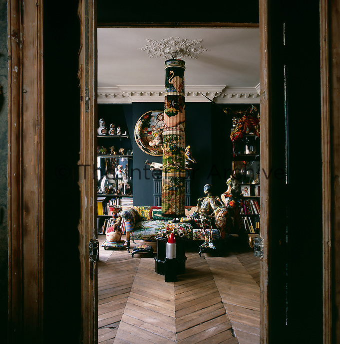 A view into one of the rooms in the apartment of artist Frederique Morrel. The apartment where she lives is also her studio and a reflection of her work. She works with tapestry to create animal heads, human figures and other objects