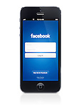 Facebook app welcome screen on display of Apple iPhone 5. Isolated on white background with clipping path.
