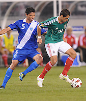 Mexico Javier Hernadez (14) shields the ball against Guatemala Carlos Gallardo (5)     Mexico defeated Guatemala 2-1 in the quaterfinals for the 2011 CONCACAF Gold Cup , at the New Meadowlands Stadium, Saturday June 18, 2011.