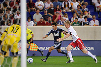 Shea Salinas (22) of the Vancouver Whitecaps is defended by Tim Ream (5) of the New York Red Bulls. The New York Red Bulls  and the Vancouver Whitecaps played to a 1-1 tie during a Major League Soccer (MLS) match at Red Bull Arena in Harrison, NJ, on September 10, 2011.