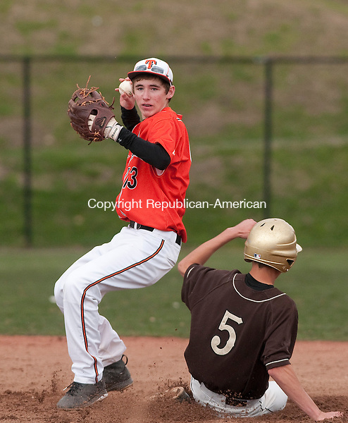 PLYMOUTH, CT--042715JS14- Terryville's Riley Zappone  (13) gets Thomaston's Jared Kahn (5) out at a force play at second base but can't turn the double-play during their game Monday at Terryville High School.<br /> Jim Shannon Republican-American
