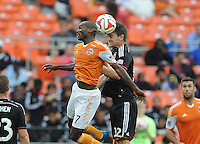 Washington D.C. - May 17, 2014:  Bobby Boswell (32) of D.C. United heads the ball against Omar Cummings (7) of Houston Dynamo. D.C. United defeated  the Houston Dynamo 2-0 during a Major League Soccer match for the 2014 season at RFK Stadium.