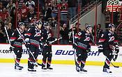 The Hurricanes celebrate Jeff Skinner's goal, permitting Carolina to take a 2-0 lead in the third period.