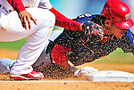 10 March 2010: Washington Nationals' shortstop Ian Desmond dives safely into third with an RBI triple during a Spring Training game against the St. Louis Cardinals at Roger Dean Stadium in Jupiter, Florida. The Cardinals defeated the Nationals 6-4 in Grapefruit League action. Mandatory Credit: Ed Wolfstein Photo