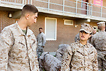 October 22, 2014. Camp LeJeune, North Carolina.<br />  LCpl. Jessica Monroy, age 19, talks with another member of her platoon after patrol training for the 3rd Platoon of the Ground Combat Element Integrated Task Force. Marines in 3rd Platoon of the GCEITF are all considered provisional infantrymen as they have not been to the School of Infantry (SOI) previous to volunteering for the GCEITF.<br />  The Ground Combat Element Integrated Task Force is a battalion level unit created in an effort to assess Marines in a series of physical and medical tests to establish baseline standards as the Corps analyze the best way to possibly integrate female Marines into combat arms occupational specialities, such as infantry personnel, for which they were previously not eligible. The unit will be comprised of approx. 650 Marines in total, with about 400 of those being volunteers, both male and female. <br />  Jeremy M. Lange for the Wall Street Journal<br /> COED