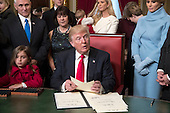 United States President Donald Trump is joined by the Congressional leadership and his family as he formally signs his cabinet nominations into law, Friday, Jan. 20, 2017, in the President's Room of the Senate on Capitol Hill in Washington. From left are, his granddaughter Arabella Rose, Vice President Mike Pence and his wife Karen Pence, Ivanka Trump, and the president's wife, Melania Trump. <br /> Credit: J. Scott Applewhite / Pool via CNP