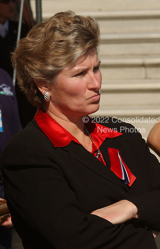 Washington, DC - September 16, 2001 -- White House Communications Director Karen Hughes listens to United States President George W. Bush's remarks as he returns from a week-end at Camp David on Sunday, September 16, 2001.  .Credit: Ron Sachs / CNP